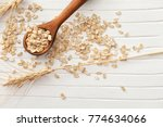 oatmeal flakes and spoon on... | Shutterstock . vector #774634066