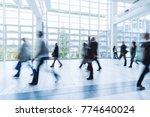blurred people walking in a... | Shutterstock . vector #774640024