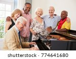 group of seniors standing by... | Shutterstock . vector #774641680