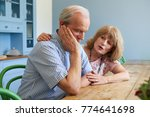 senior woman comforting man... | Shutterstock . vector #774641698