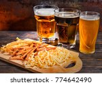 three glasses with light ... | Shutterstock . vector #774642490