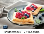 plate with tasty berry pastries ... | Shutterstock . vector #774665086