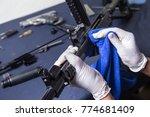 gunsmith cleaning gun rifle and ...   Shutterstock . vector #774681409