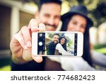 smiling young couple take a... | Shutterstock . vector #774682423