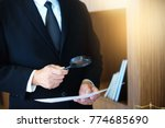 Small photo of Judge lawyer read paper text by use Magnify glass concept law firm