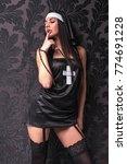 beautiful girl dressed as a nun | Shutterstock . vector #774691228