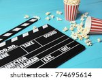 clapperboard and popcorn on... | Shutterstock . vector #774695614