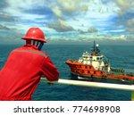 offshore worker looking at... | Shutterstock . vector #774698908