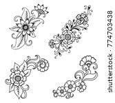 henna tattoo flower template in ... | Shutterstock .eps vector #774703438