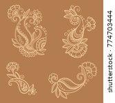 henna tattoo flower template in ... | Shutterstock .eps vector #774703444