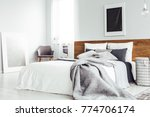 grey blanket on bed with wooden ... | Shutterstock . vector #774706174