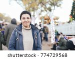 a young woman on christmas... | Shutterstock . vector #774729568