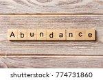 abundance word written on wood...   Shutterstock . vector #774731860