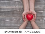 adult and child hands holding... | Shutterstock . vector #774732208