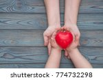 adult and child hands holding... | Shutterstock . vector #774732298