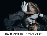 screaming woman with... | Shutterstock . vector #774760519