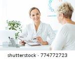 smiling nutritionist showing a... | Shutterstock . vector #774772723