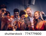 group of friends celebrating at ... | Shutterstock . vector #774779800