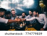 group of young men toasting... | Shutterstock . vector #774779839