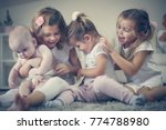 little sisters take care baby... | Shutterstock . vector #774788980