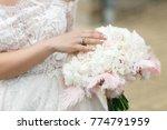 bride holds her hand on tender... | Shutterstock . vector #774791959