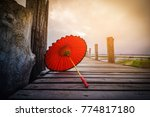 Red umbrella on u bein bridge...