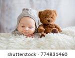 sweet baby boy in bear overall  ... | Shutterstock . vector #774831460