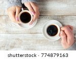 cups with a coffee in the hands ... | Shutterstock . vector #774879163
