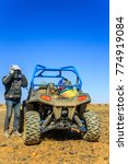 Small photo of Ait Saoun, Morocco - February 23, 2016: Man preparing to ride a quad bike along the sandy desert Ait Saoun in Morocco.