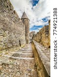 Small photo of Carcassonne, France - July 08, 2014: The medieval city of Carcassonne, is one of the main fortresses of Albigensian crusade, France
