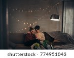 romantic young couple relaxing... | Shutterstock . vector #774951043