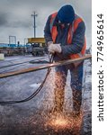 Small photo of welder work at bridge span joints