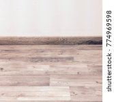 wood floor with a white painted ... | Shutterstock . vector #774969598