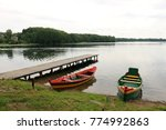 boat on the shore of a big lake | Shutterstock . vector #774992863