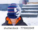 A Young Boy With A Winter Hat...