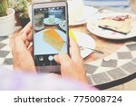woman's hand taking photo of... | Shutterstock . vector #775008724