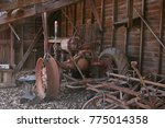 Old Tractor Sitting In A Barn