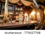 unfocused interior of... | Shutterstock . vector #775027708