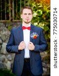 groom at wedding tuxedo smiling ... | Shutterstock . vector #775030714
