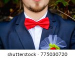 groom at wedding tuxedo smiling ... | Shutterstock . vector #775030720