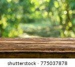 empty wooden table background | Shutterstock . vector #775037878