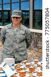 Small photo of CHEYENNE, WY. JUNE 5, 2014. CIRCA: Air force female soldier serving sweets at a military installation reception in Cheyenne, Wy.