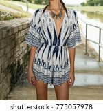 model in a print romper   Shutterstock . vector #775057978