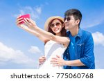 couple selfie happily with the... | Shutterstock . vector #775060768