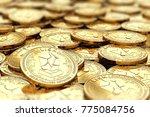 stack of golden lisk coins in... | Shutterstock . vector #775084756