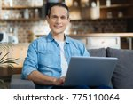freelancer. cheerful man... | Shutterstock . vector #775110064