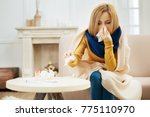 runny nose. ill young blond... | Shutterstock . vector #775110970