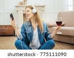 relaxing to music. pretty... | Shutterstock . vector #775111090
