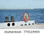 red lifebuoy and bollard on... | Shutterstock . vector #775119454