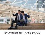 asian two businessman happy...   Shutterstock . vector #775119739